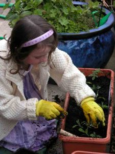 Girl planting - ideas for family garden